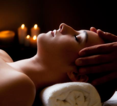 ascent-spa-woman-candles-458x415-istock_15410776